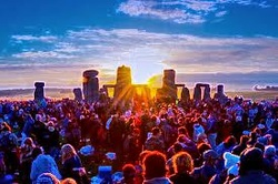 photo of stone henge and sunrise gathering