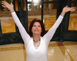 Photo of joyful woman with arms extended up