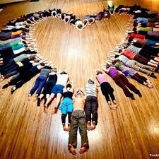 people lying on the floor in the shape of a heart